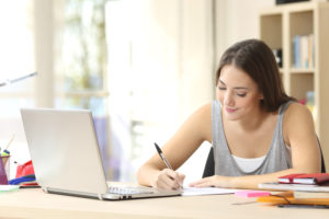 woman writing and typing