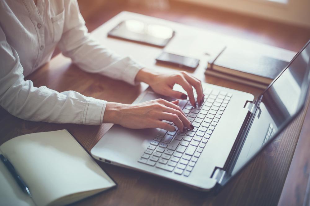 woman writer typing